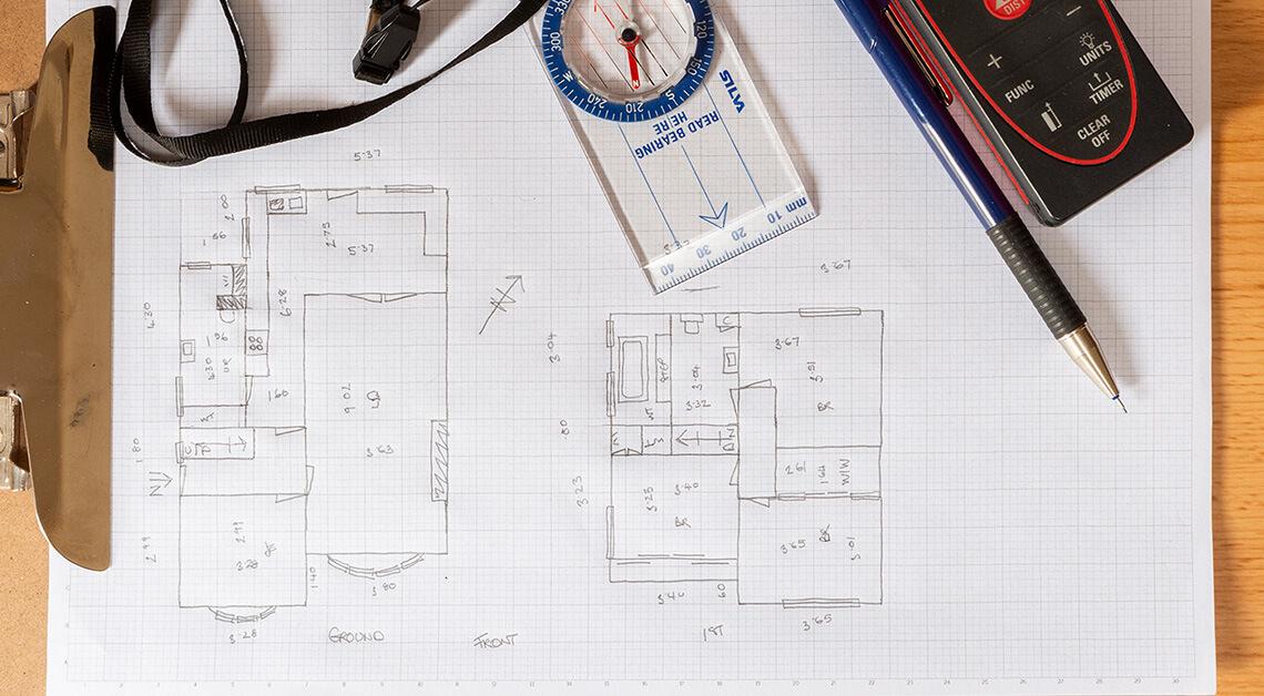 Grid paper, laser measure, clip board and pencil