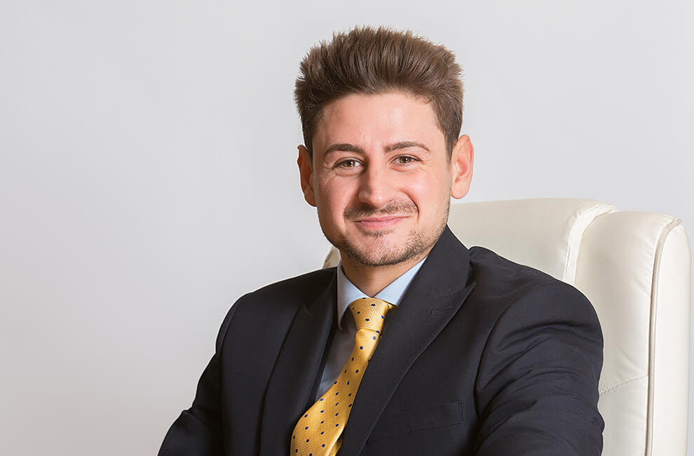 Professional headshot of an estate agent