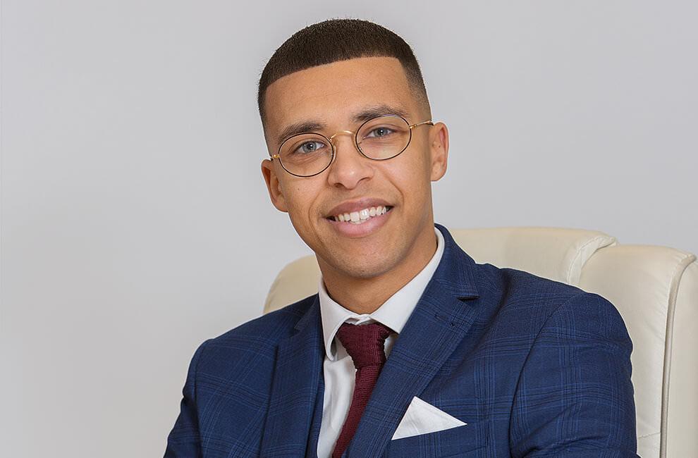 Professional headshot of a male estate agent